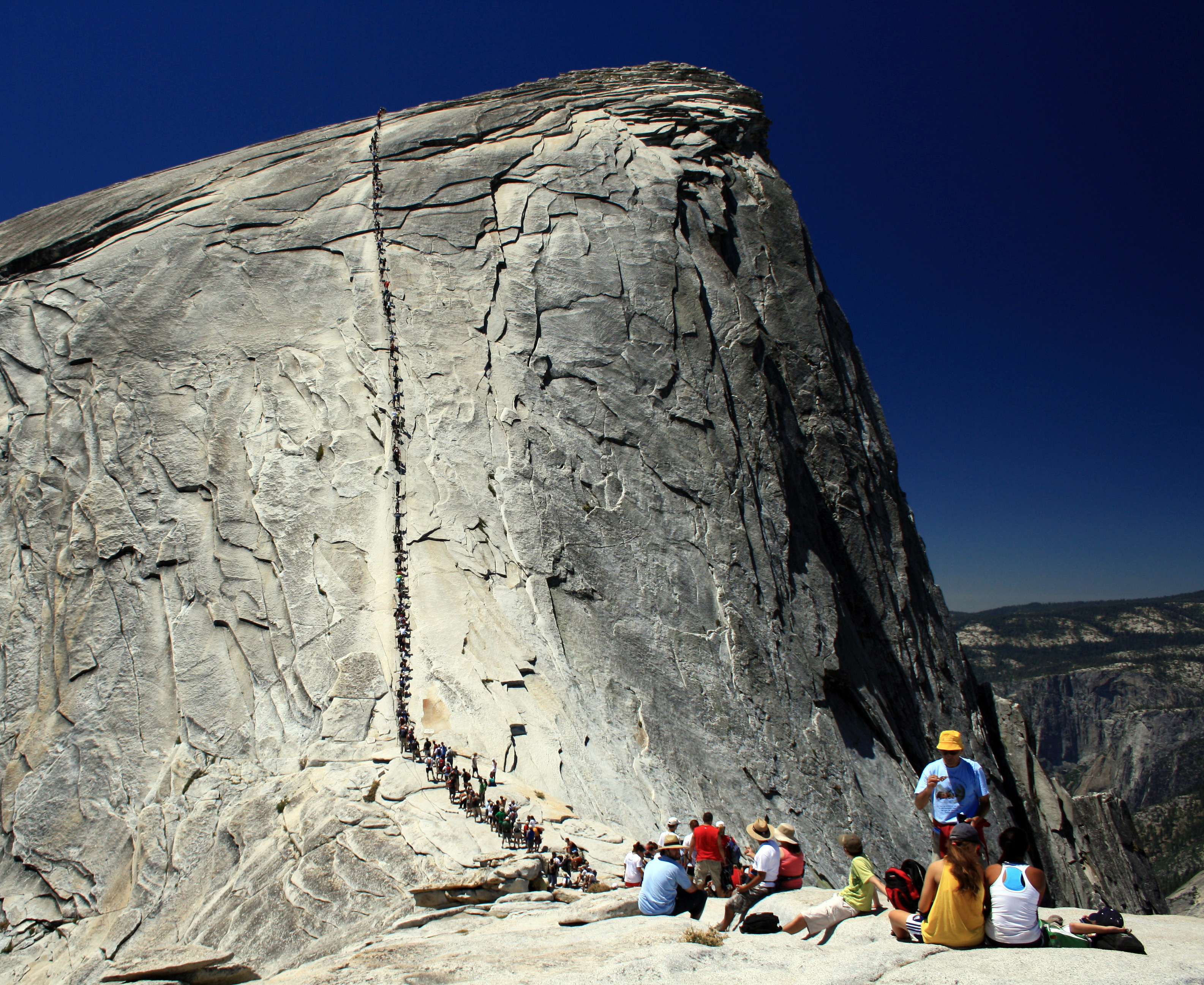 Visitors hiking up Half Dome at Yosemite