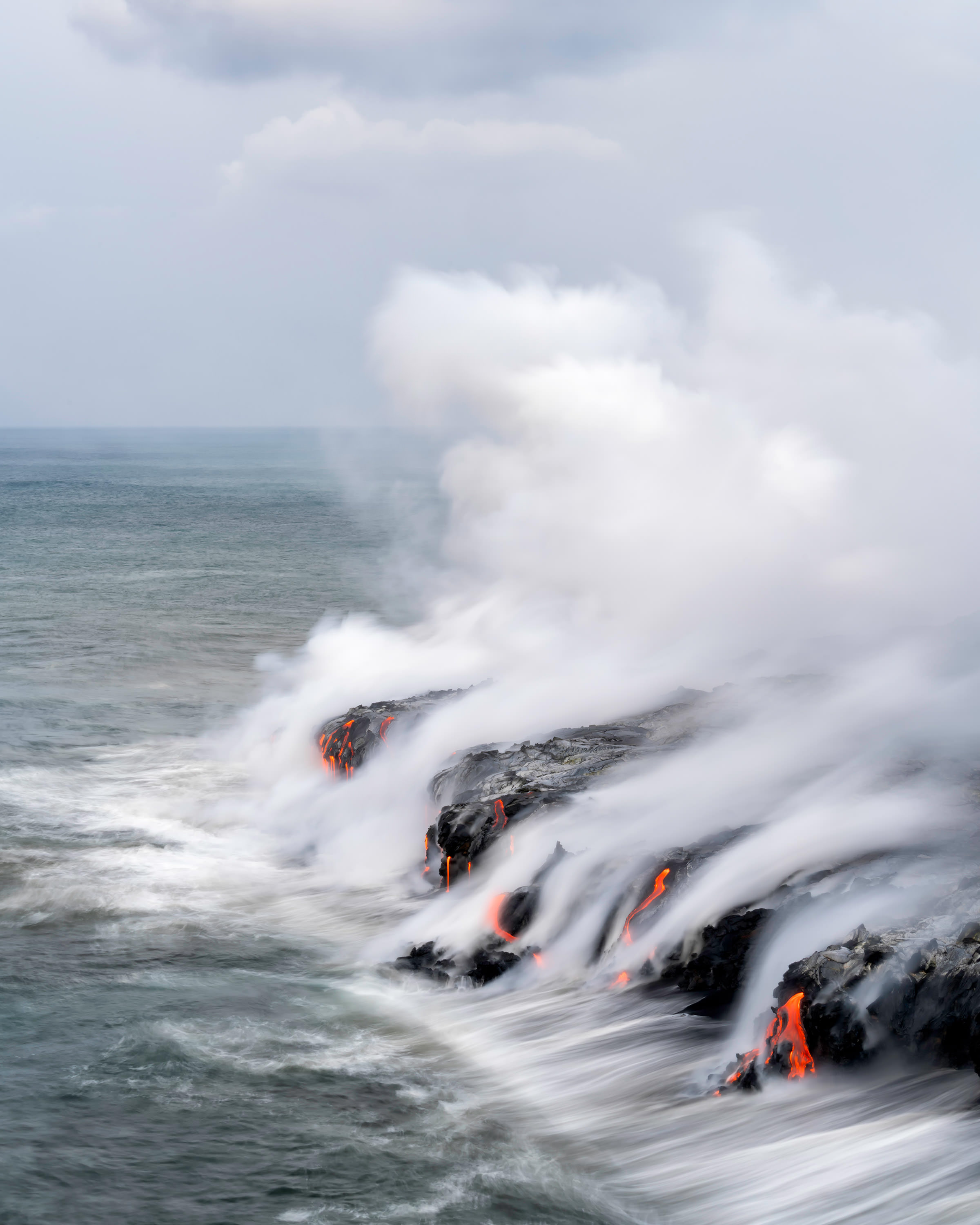 Hot lava rushes into the sea in Hawaii