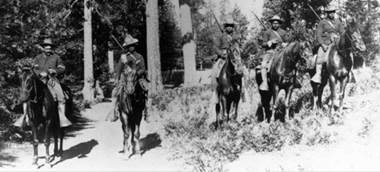 black and white historical photo of African American buffalo soldiers in Yosemite National Park