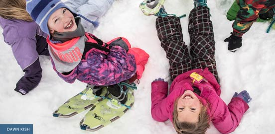 Fourth graders play in the snow while on an EKiP program trip