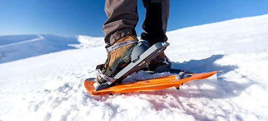 close-up view of snowshoeing on a hill of snow