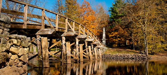 Minute Man National Historical Park bridge on a bright fall day with colorful leaves