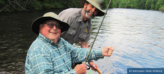 Fisherman and National Park Service ranger fishing on Saint Croix National Scenic Riverway