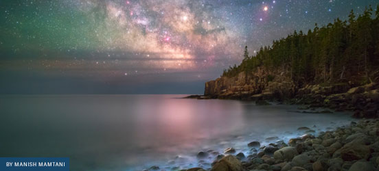 Starry night sky over Acadia National Park shoreline, photo by Share the Experience grand prize winner Manish Mamtani