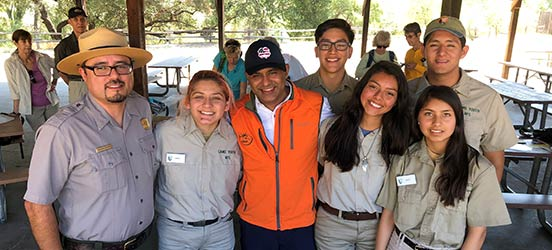 Dr. Chilimuri smiles for a group picture with park employees at Yellowstone National Park