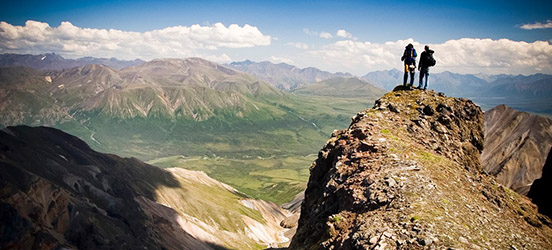 Hikers on a peak at St Elias National Park and Preserve