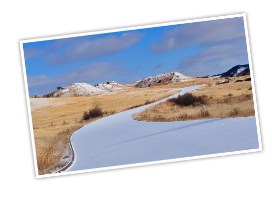 Snow dusted path and rolling flat lands at Theodore Roosevelt National Park