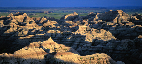 A wide landscape of the buttes and pinnacles in Badlands National Park