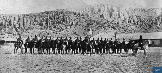 Historic image of many African-American soldiers mounted on horses