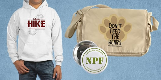 A sweatshirt, pin, and messenger bag available at the National Park Foundation merchandise store