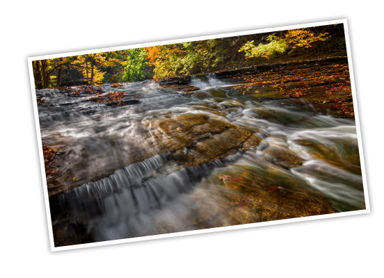 National Park Foundation, GoParks newsletter graphic cover image of the Cuyahoga River flowing down sloped rocks, creating mini waterfalls, with fall trees lining the edge