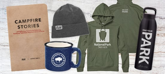 Collage of merchandise from the Find Your Park store, including a ceramic camping mug, a sweatshirt, a water bottle, a beanie hat, and a book of campfire stories