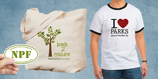 A sticker, tote bag, and tshirt, all available at the National Park Foundation merchandise store