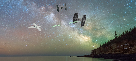 The colorful night sky at Acadia National Park is the back drop to two TIE fighters shoot at an X-wing as it flies away