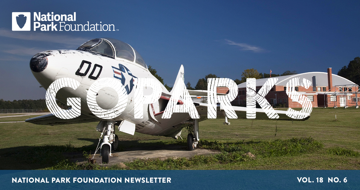 National Park Foundation, GoParks newsletter graphic cover image of a World War Two plane sits in front of a red brick hanger at Tuskegee Airmen National Historic Site