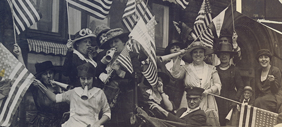 The historic image of women waiving American flags to celebrate the passing of the 19th Amendment