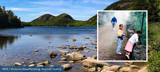 A background image of a body of water lined with a pebble shore, evergreens, and a double mounded hill in Acadia National Park serves as the background for the small family photo collaged on top. The small photo shows two children walking along a trail, peering over a boulder into the forest beyond it, as their Grandfather walks ahead of them