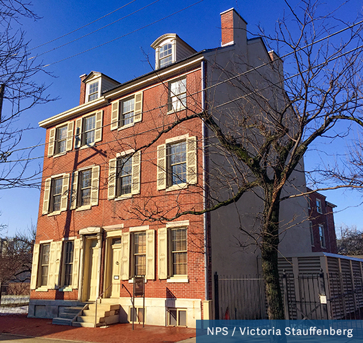 A four story red brick duplex with cream shutters was once home to Edgar Allen Poe