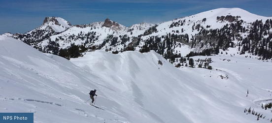 A person skiis down a snowy mountain in Lassen Volcanic National Park