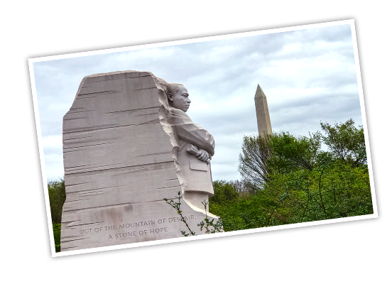 Martin Luther King, Jr. Memorial with trees and the Washington Monument in the background