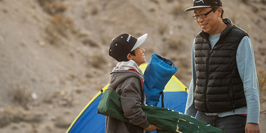 A father and son set up a tent in Death Valley National Park