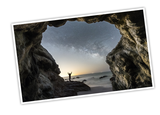 The mouth of a cave opening onto a starlit beach and the silhouette of a person standing with their arms outstretched, a few animated lines spring out from the arms to highlight the GoParks title