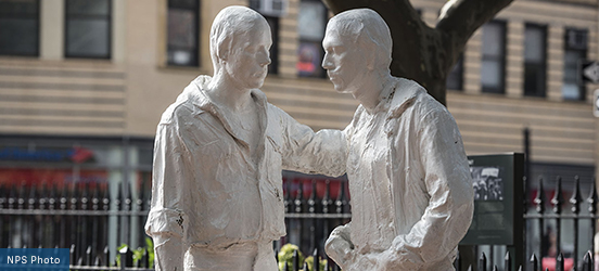 A sculpture by George Segal of two men painted white at Stonewall National Monument located in historic Christopher Park