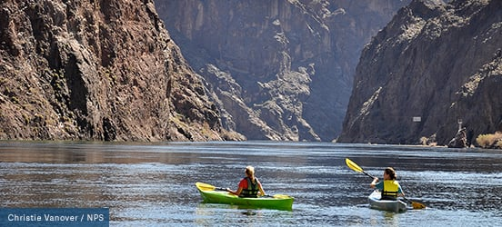 Two kayakers paddle through the water at Lake Mead National Recreation Area
