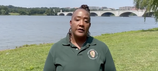 A video still taken from the Park Ambassadors series of NPS Project Manager Karen Arey as she stands in front of the Potomac River in Washington, D.C.
