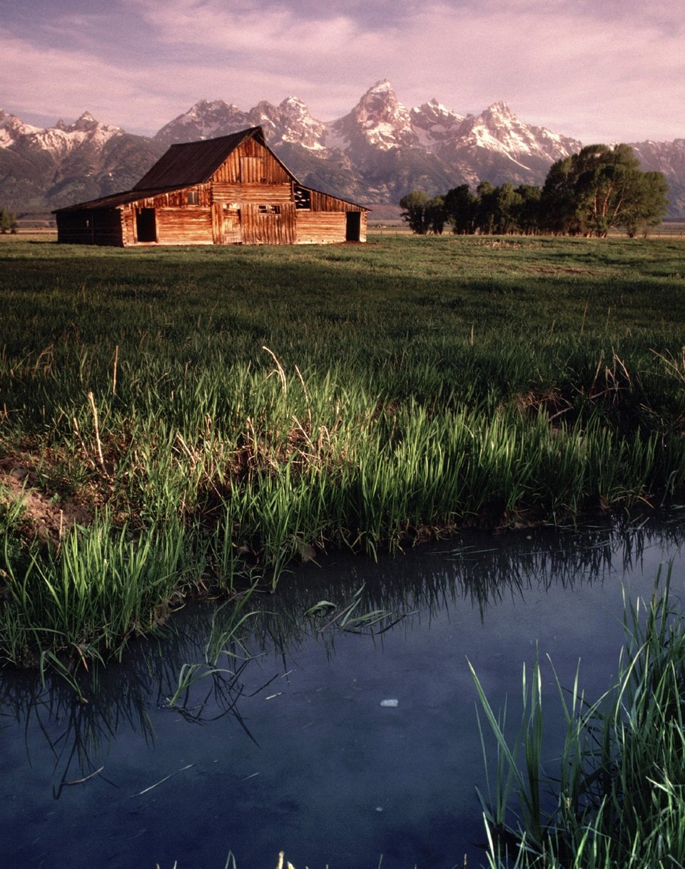 An historic barn sits at the foothills of the Tetons