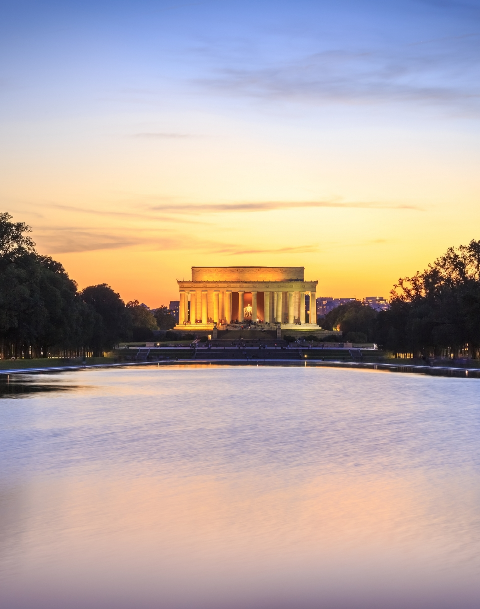 The Lincoln Memorial at sunset with the reflecting pool in the foreground