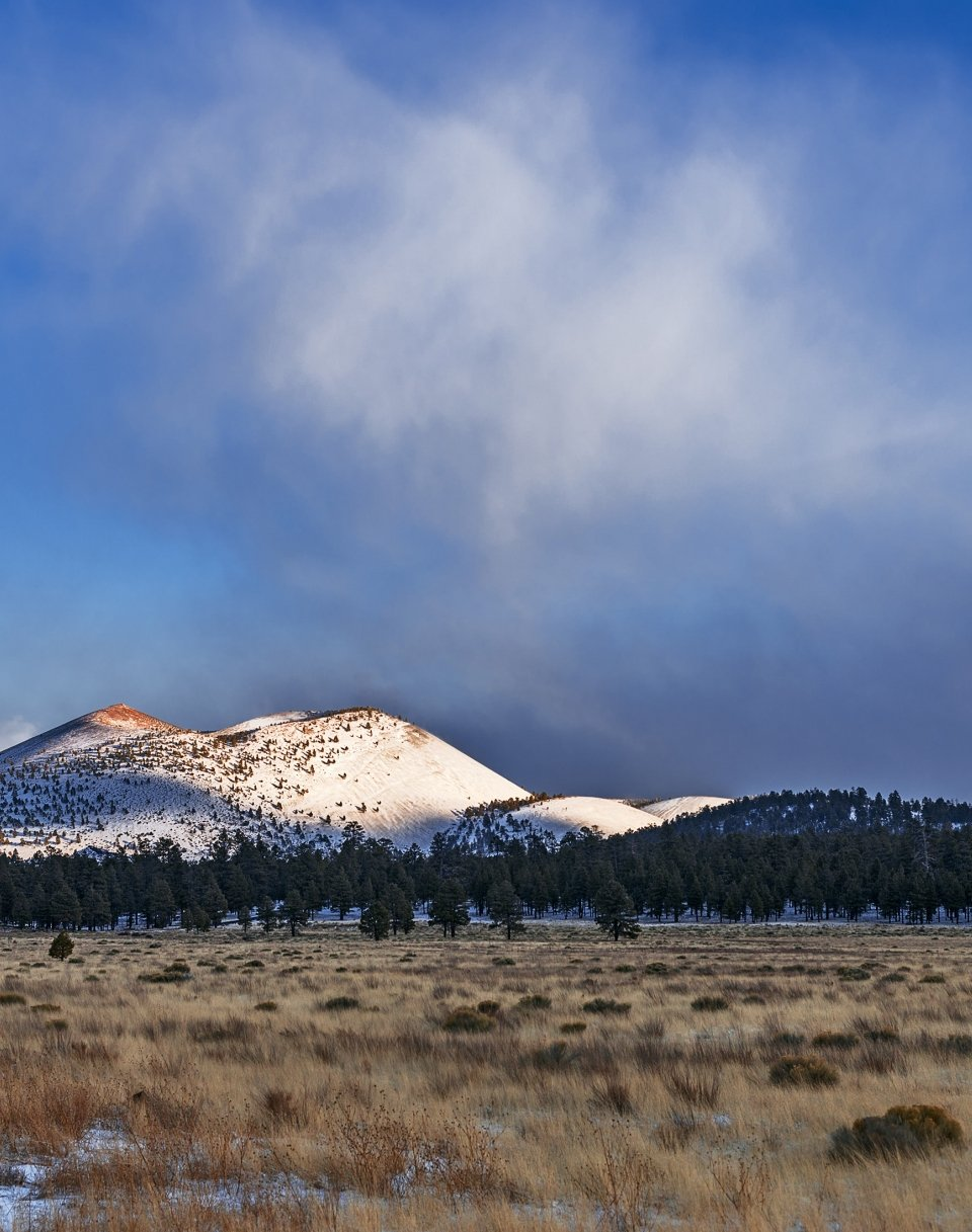 Sunset Crater landscape with sunlight and snow