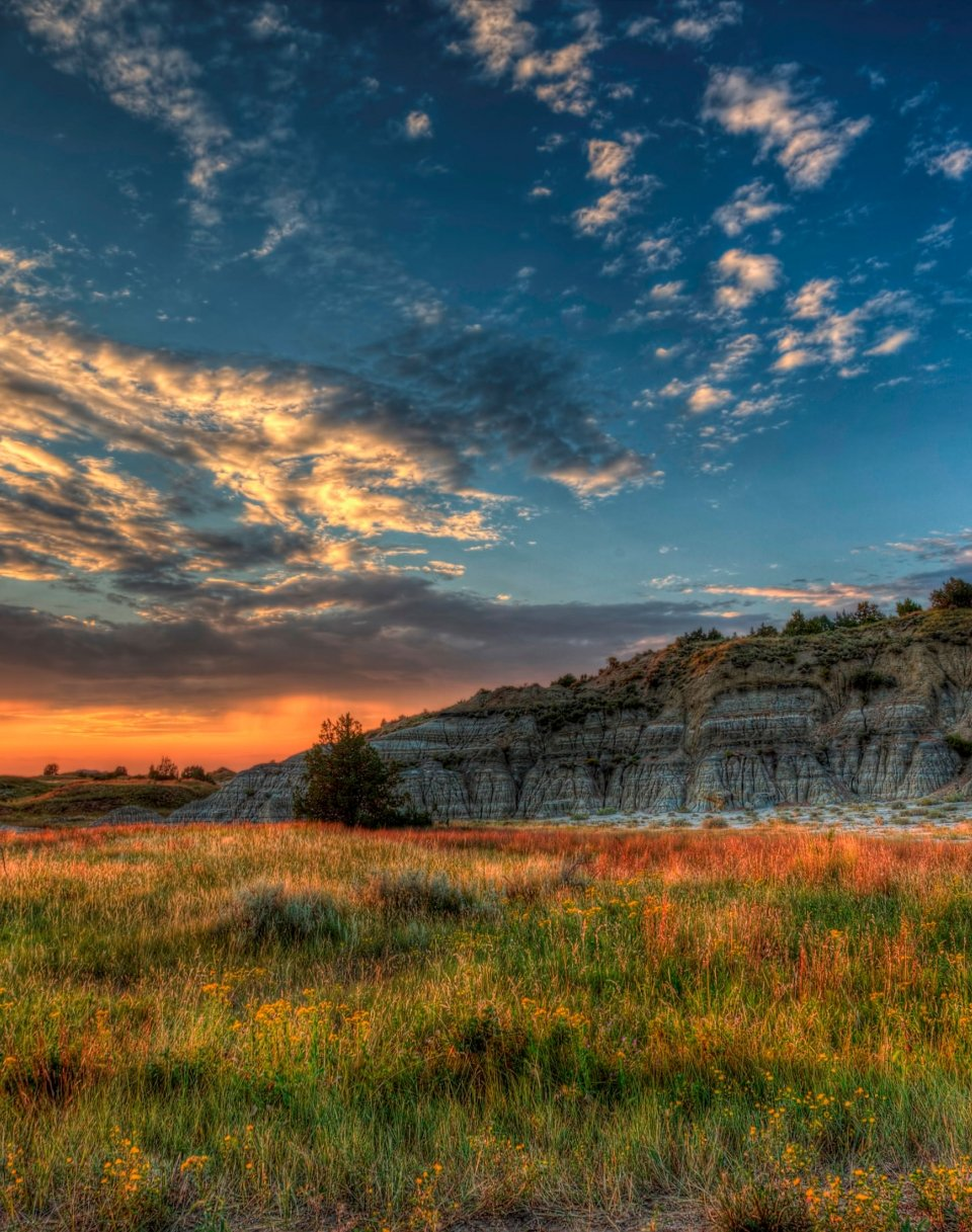 Butte landscape with prairie grass at sunset