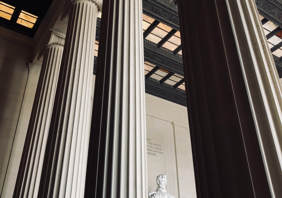 The Lincoln Memorial statue viewed through its iconic columns