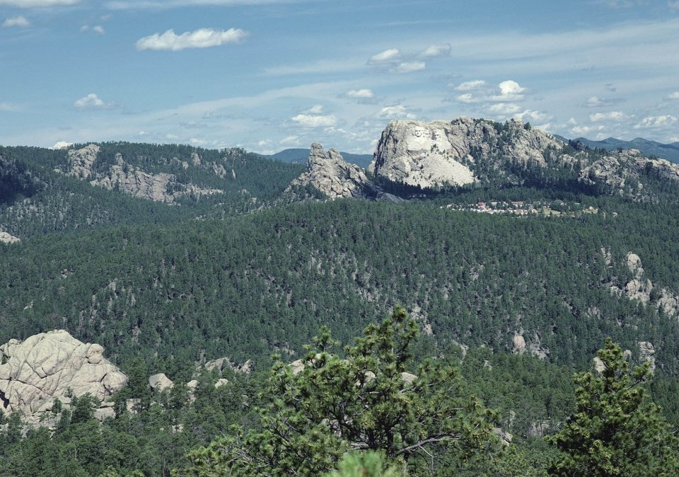 A faraway shot of Mt. Rushmore, showing the beauty of the Black Hills