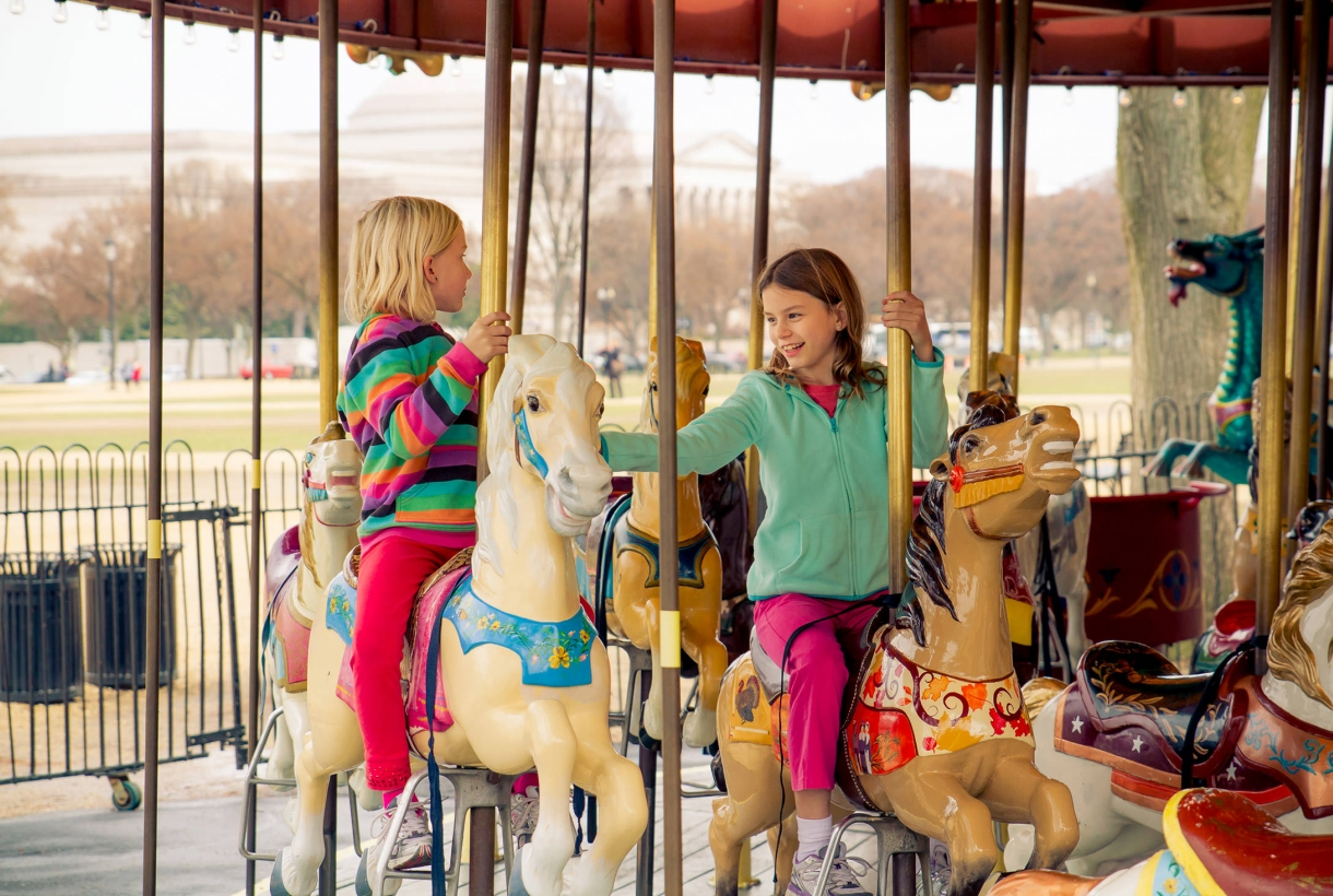 Children riding National Mall Carousel