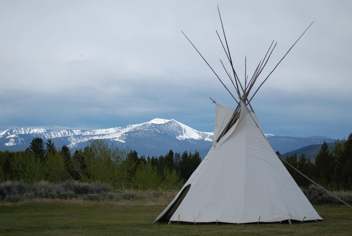 Tipi with mountains in the background