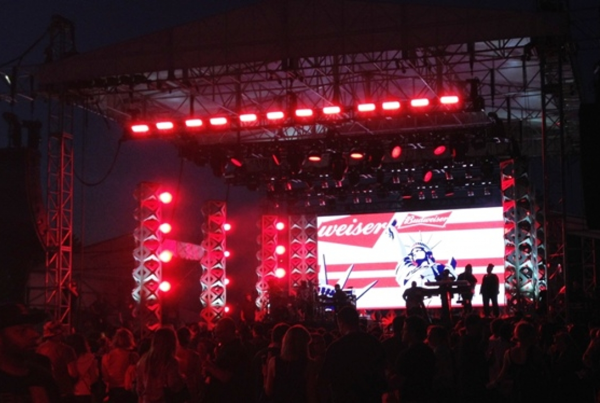Concert stage with Budweiser image displayed on screen
