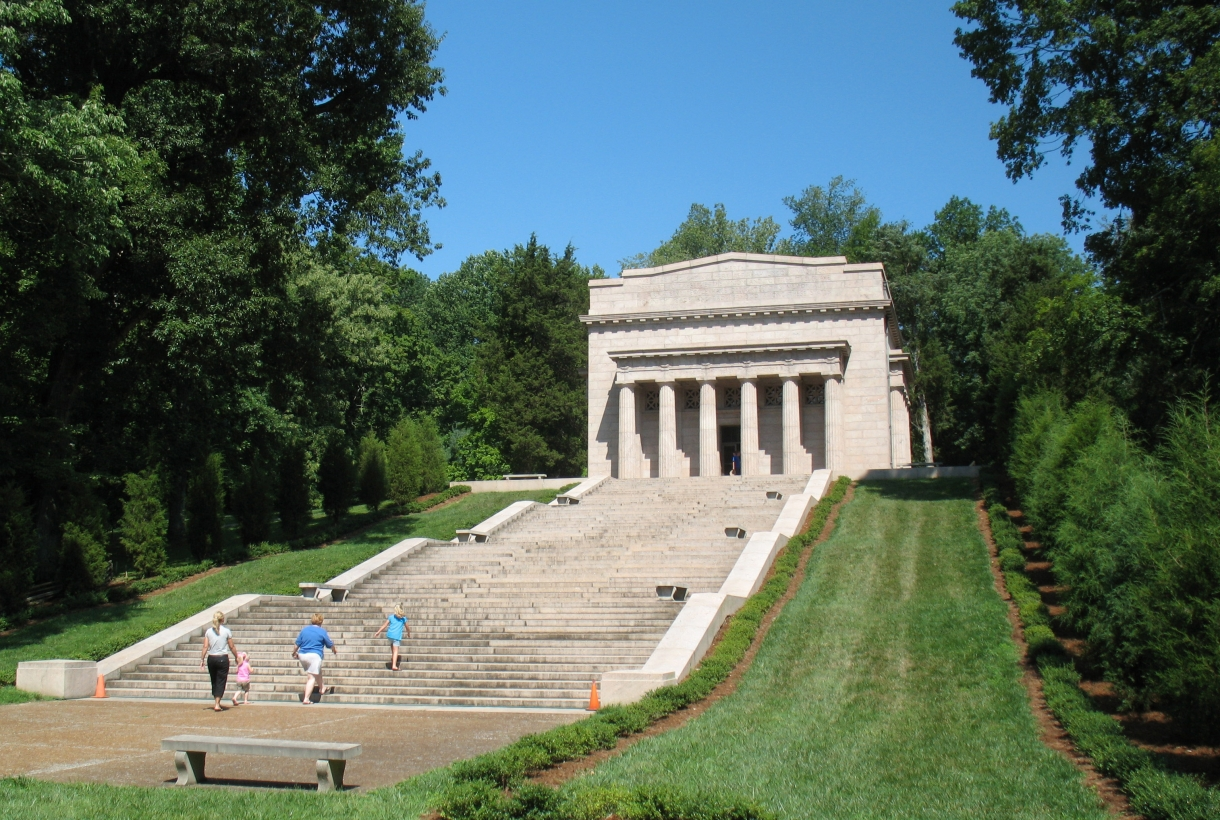 A family walking up the stairs to the Abraham Lincoln Birthplace National Historic Site