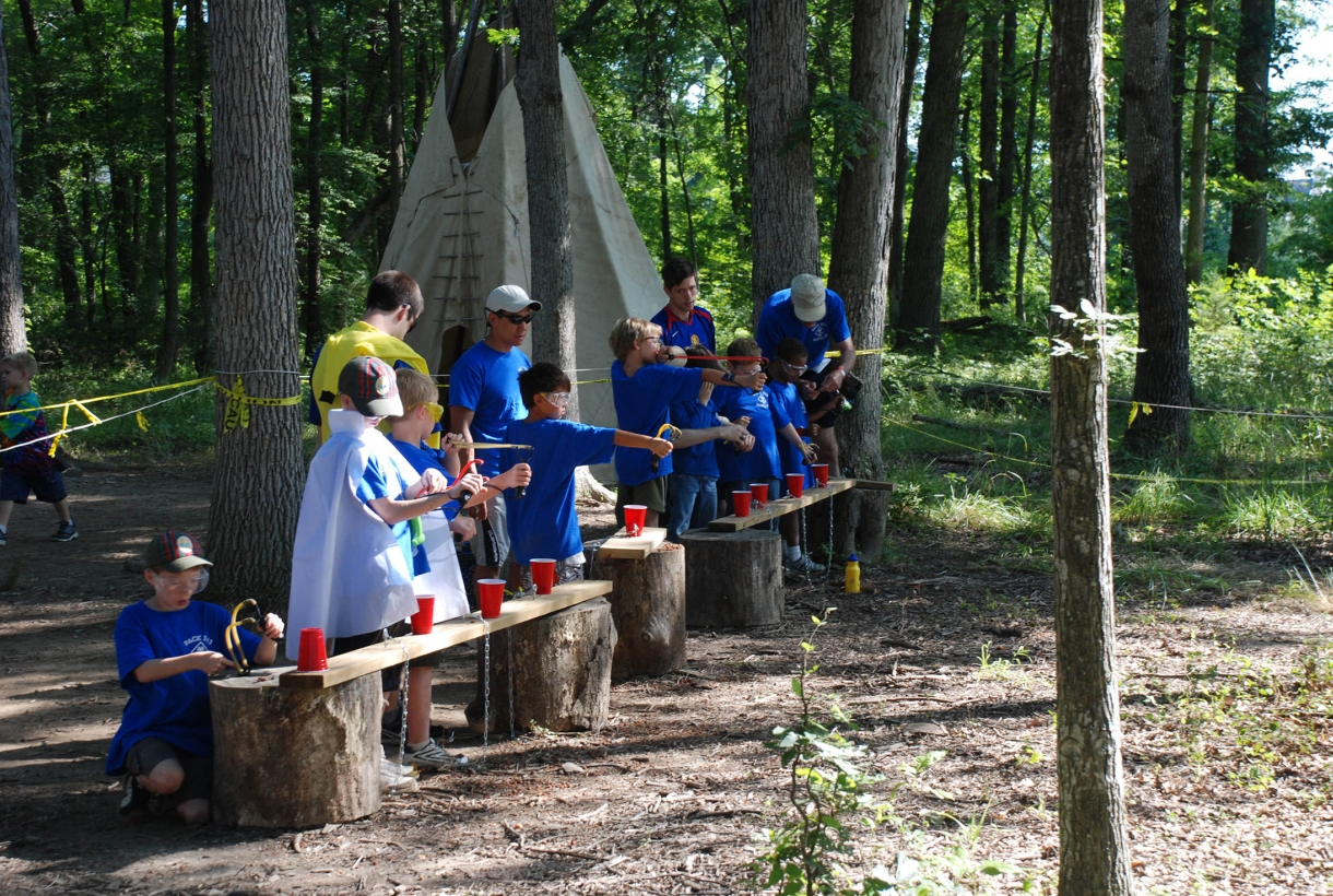 Kids perform a science experiment in the woods