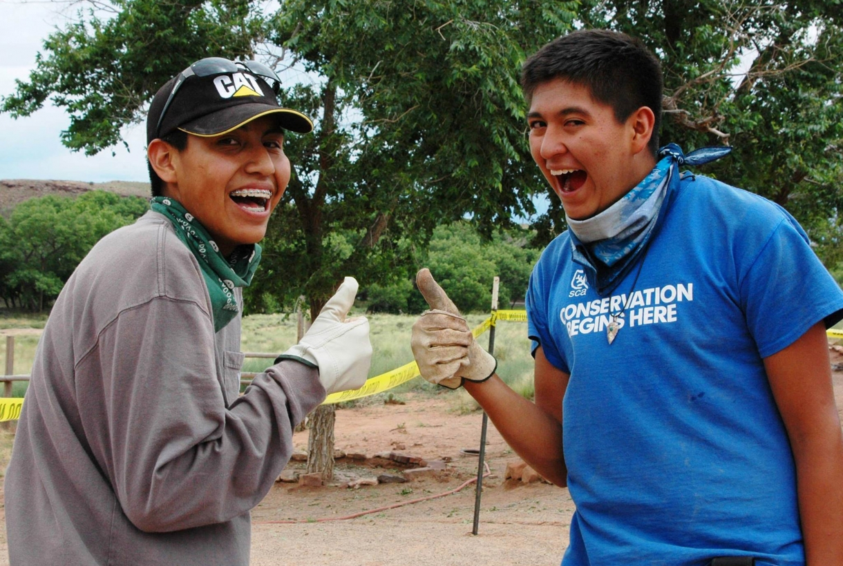 Two happy teens helping at Canyon de Chelly