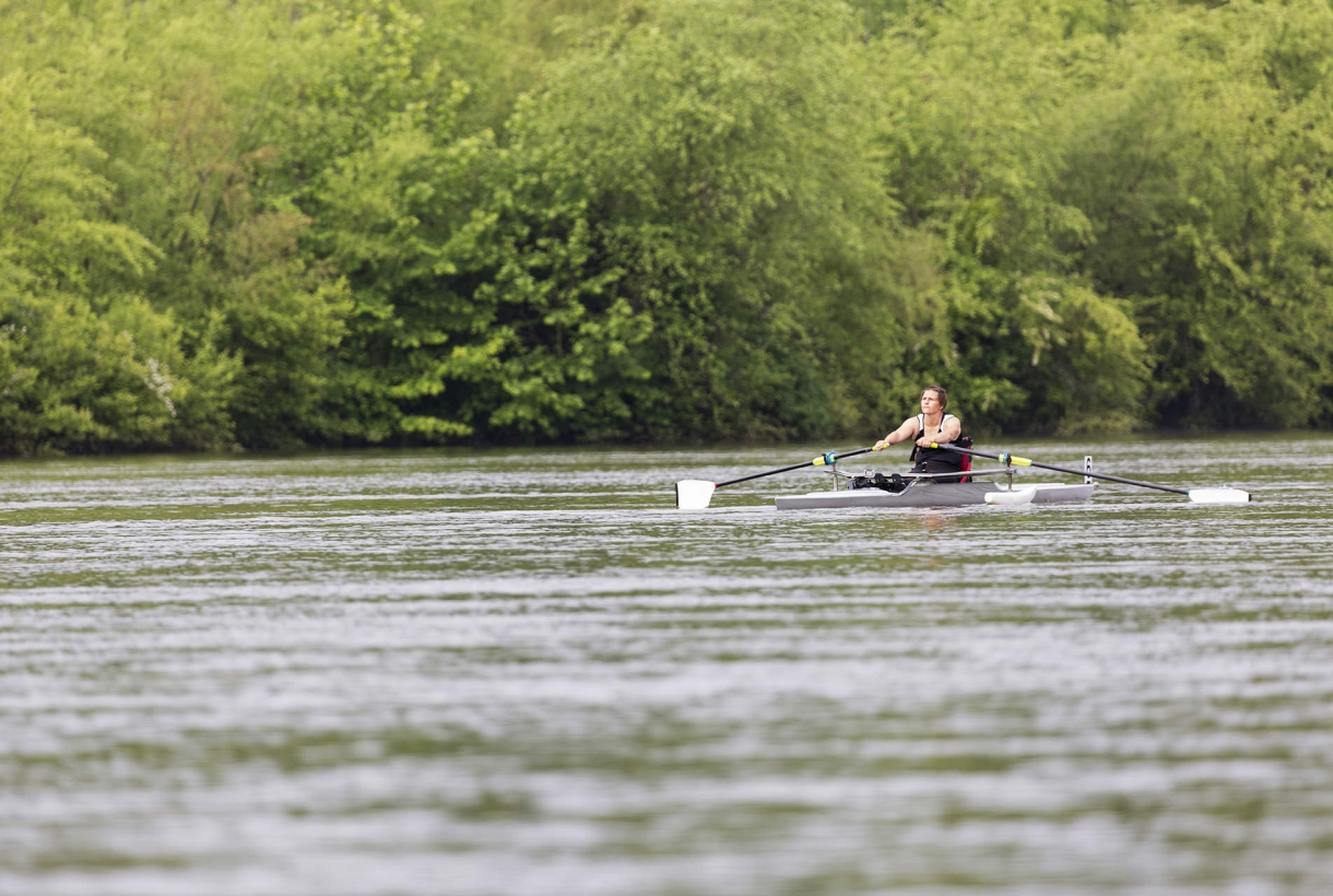 Man rowing kayak on river