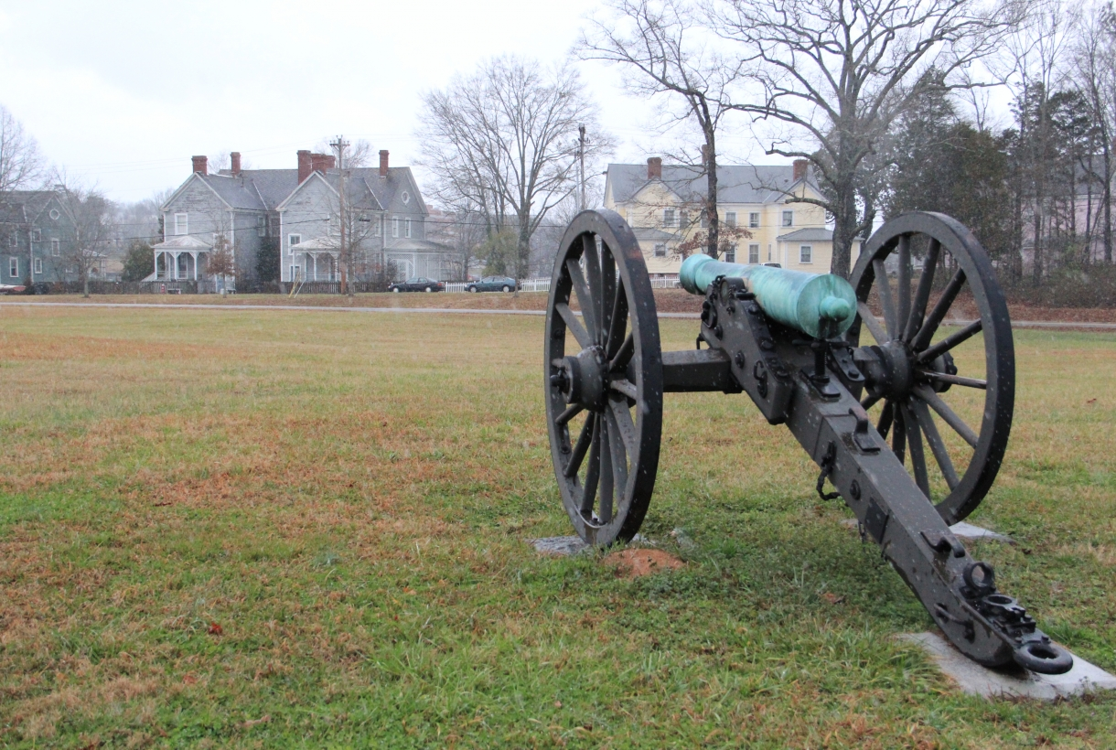 a cannon at chickamauga and chattanooga national military park with the town of fort oglethorpe in the background