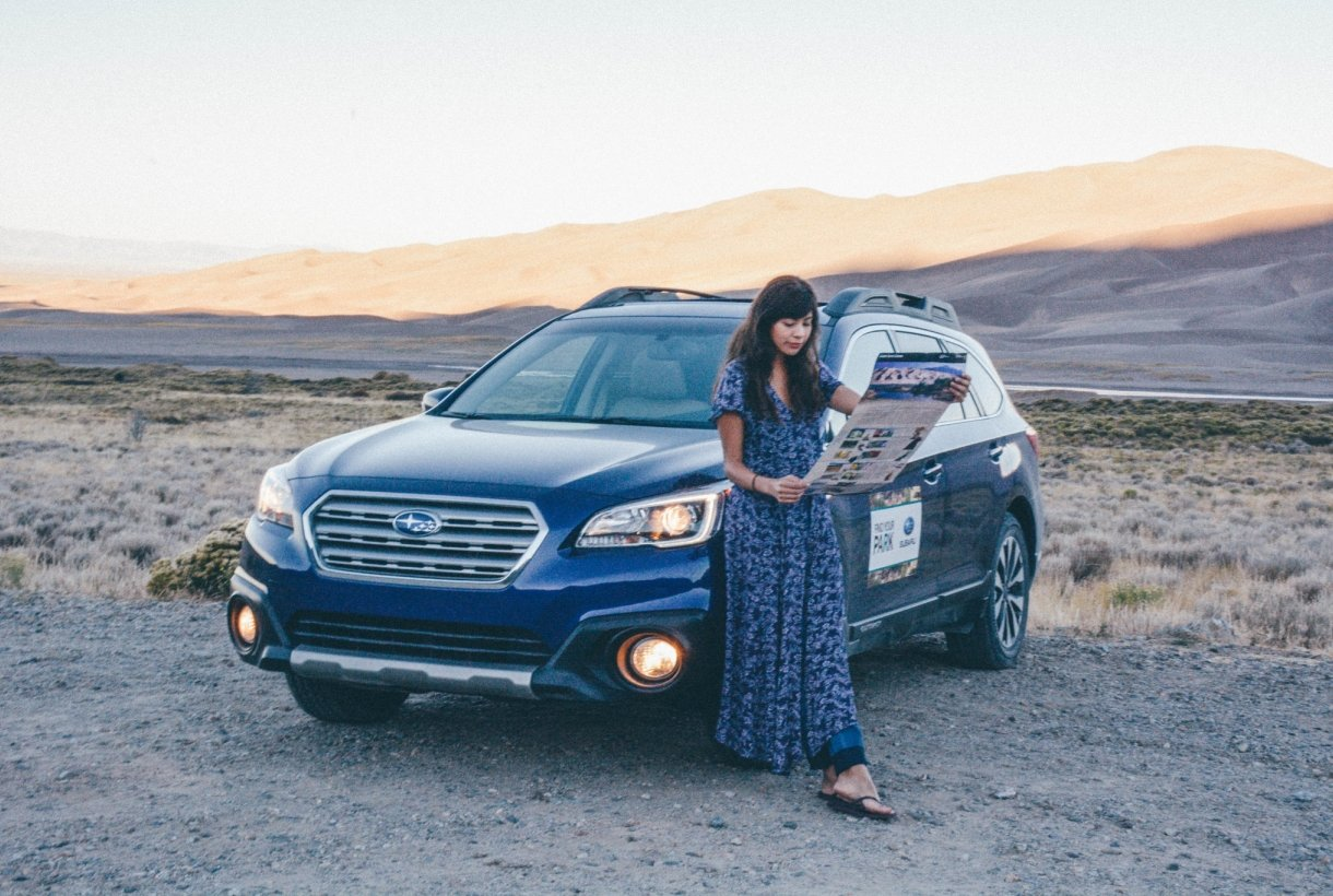 Grace with Blue Subaru reading Map