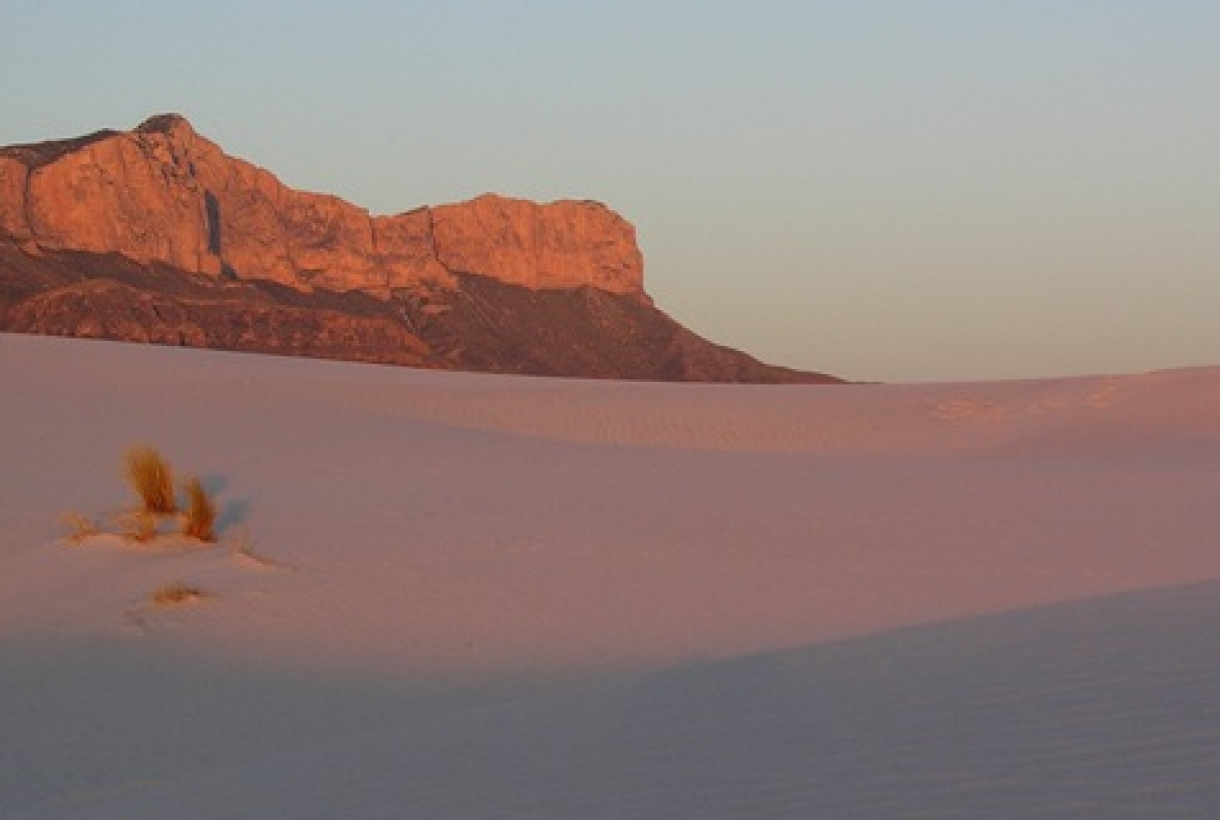 Guadalupe mountains and desert sands at dusk