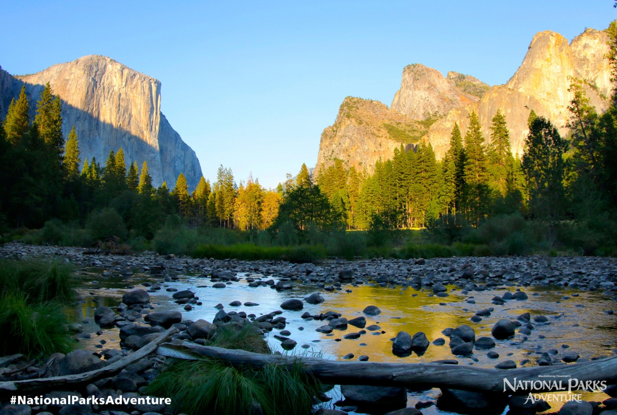 Yosemite Valley with a sunrise-lit El Capitan in the background.
