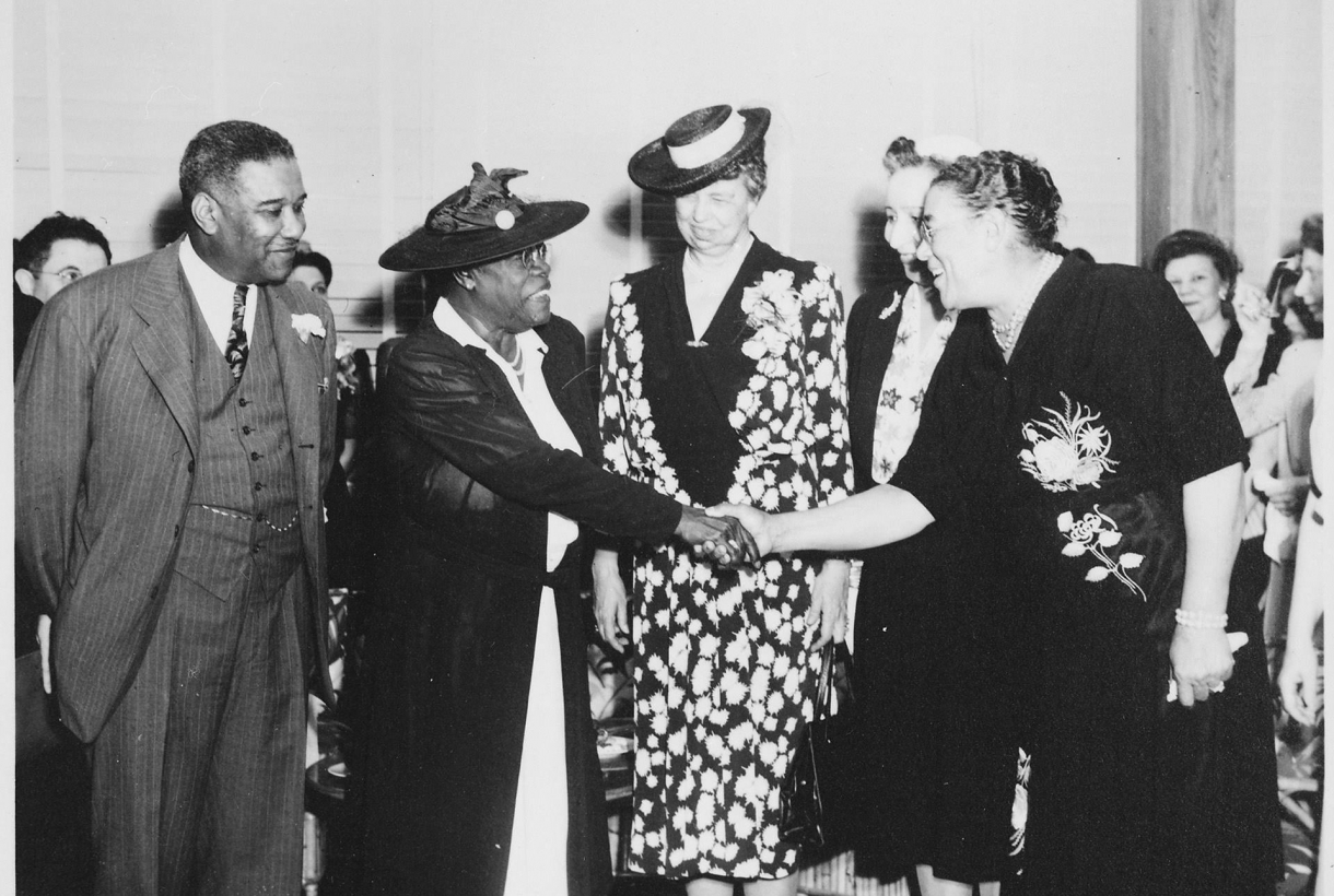 Black and White Image of Mary McLeod Shaking Hands with Women
