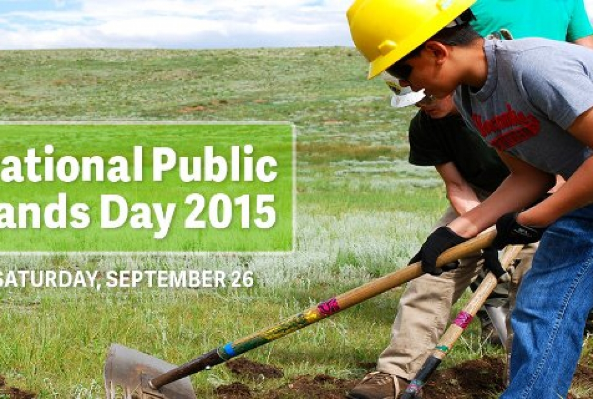 """Man shoveling ground, text reads, """"National Public Lands Day 2015, Saturday, September 26"""""""