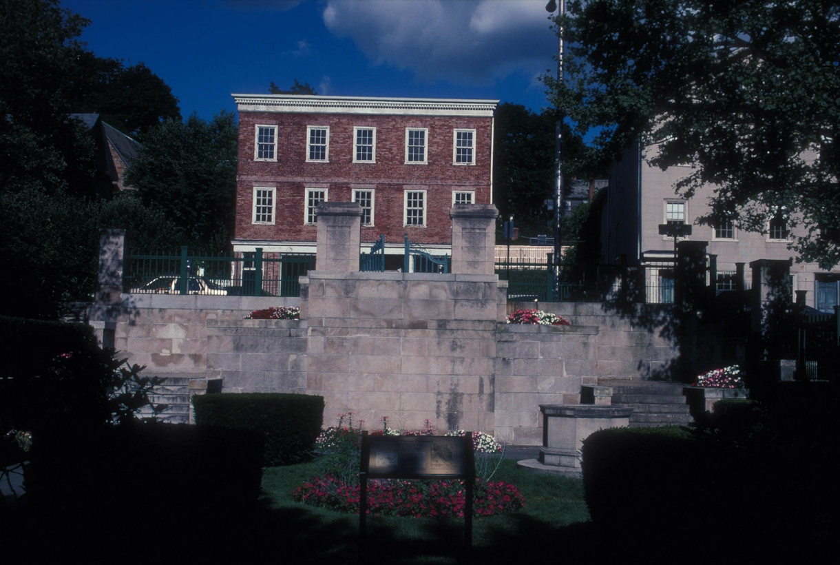 memorial steps leading to colonial style red brick building