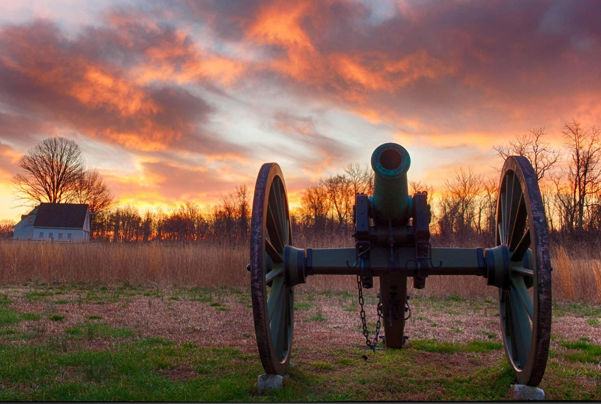 cannon against sunset on battlefield